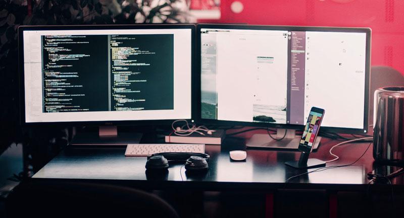 Website designer's dual screen workspace