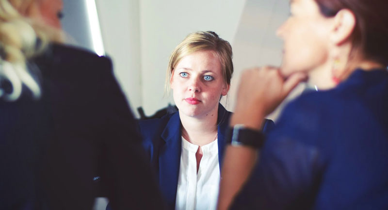 Woman looking uncomfortable in meeting