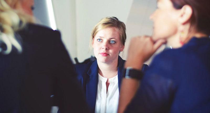 Woman looking uncomfortable in meeting