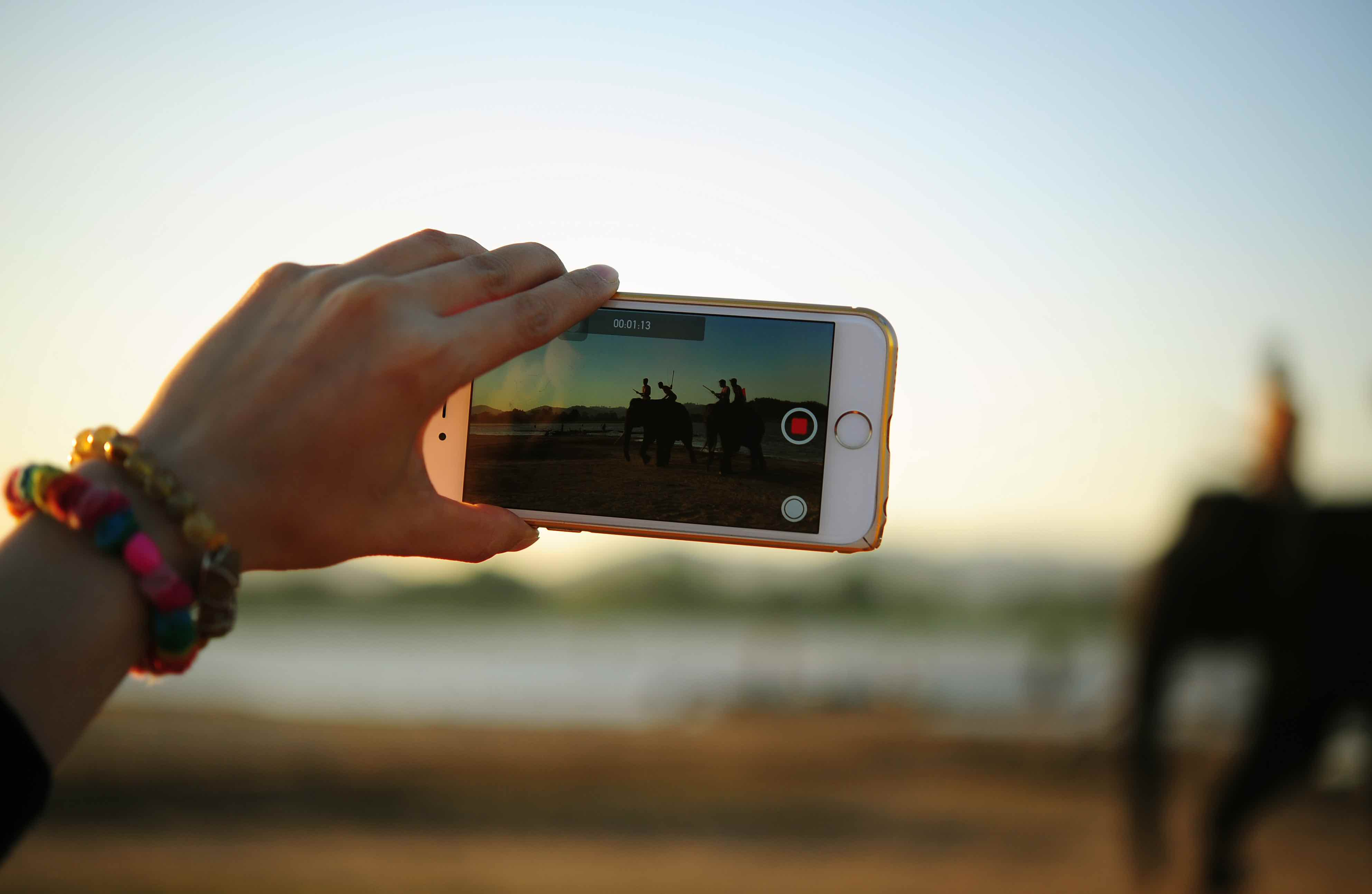 Visual Content Woman Taking Video on Mobile