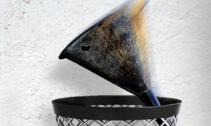 A funnel is thrown into a trash bin